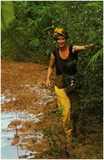 Helena wading through Jungle in Madagascar